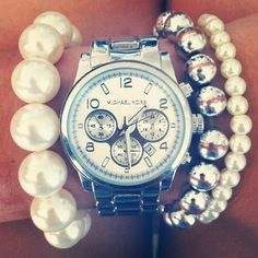 Love the Michael Kors watch paired with the bracelets
