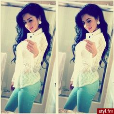 White lace blouse, light blue skinnies and stud earrings.