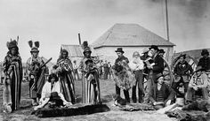 Big Bear and party trading at Fort Pitt, 1884. Cree L-R: Four Sky Thunder, Skybird, Matoose (sitting), Napasis, Big Bear, Angus McKay, Edward Dufresne, L. Goulet, Stanley Simpson, Rowley (seated), Alex McDonald (in rear), Corporal Sleigh, Mr Edmund, Henry Dufresne. The hats worn by he Indians were clearly popular trade items.