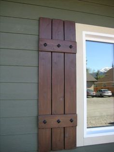 Shutters... We just did this. We used 5 inch cedar tongue and groove ...