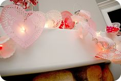 lights with doilies and cupcake liners to fancy it up!