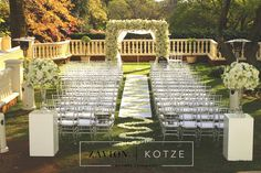 Wedding ceremony and floral arch to die for! This amazing white floral arch flower arch for a perfect bride.. white mass arrangements. white wedding, amazing wedding flowers, royal white floral wedding.