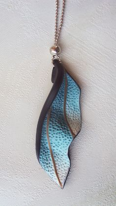 Sea leaf pendant by Polymer Claus. Beautiful. I am looking for a leaf or feather pendant. Love
