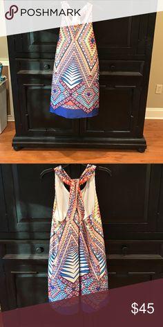Fun summer dress. Multicolored dress with adorable back detailing. Bisou Bisou Dresses