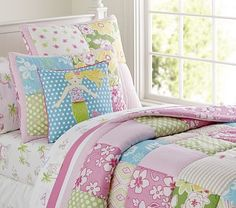 Key West Quilted Bedding #pbkids Full/Queen Add a little island style to kids' beds with this pieced patchwork quilt. Squares of sunny-day patterns and tropical prints are paired with island scenes to create a lofty cotton quilt kids will love. Pure cotton. Polyester batting. Pre-washed for added softness. Sewn with patches of percale, voile and seersucker, and then hand quilted. Quilt and shams reverse to a printed floral pattern on pink ground. Quilted shams have a tie closure.