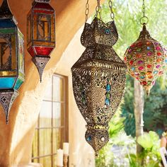 Gypsy Gem Embellished Boho Hanging Lantern Our jewel-encrusted, cast iron lantern evokes a Moroccan bazaar& a hint of a handcrafted stained glass window thrown in for good measure. Morrocan Decor, Moroccan Bedroom, Moroccan Lanterns, Moroccan Interiors, Moroccan Lighting, Outdoor Lighting, Romantic Home Decor, Romantic Homes, Hanging Lanterns