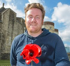 Poppy appeal: Artist Paul Cummins planned the project for 888,246 ceramic flowers to be planted at the Tower of London and all will be sold ...