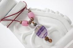 Now trending: Unique Gemstone Necklace, Boho Pendant, Purple and Pink Jewelry with Copper and Tigers Eye, Fluorite Pendant https://www.etsy.com/listing/522356740/unique-gemstone-necklace-boho-pendant?utm_campaign=crowdfire&utm_content=crowdfire&utm_medium=social&utm_source=pinterest