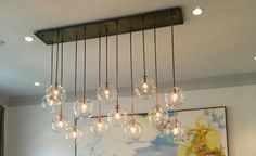 A favorite new pendant designed by #geraldolesker. #bronze and #pyrex chandelier