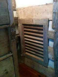 This return vent was made from weathered barnwood and is right at home with hand hewn logs and dove tail notches.