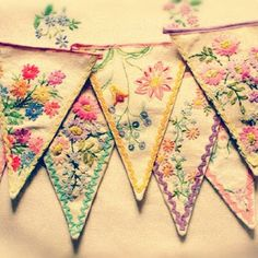 vintage textiles into bunting...from Feeling Stitchy.