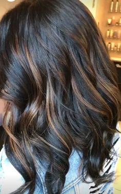 Dark brunette with caramel highlights
