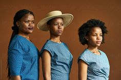 A portrait of African sisters wearing modern traditional shweshwe clothing against a brown background. Stylist: Bielle Bellingham Phootgrapher: Micky Wiswedal Hat: Crystal Birch Modern Traditional, Birch, Stylists, Sisters, African, The Unit, Hat, Crystal, Stock Photos