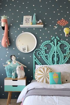 Wow, check out this colorful vintage decor with all kind of cool stuff. Perfect for your baby girl bedroom!