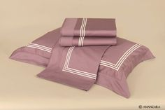 Egyptian cotton sateen sheets with cream embroidered lines.