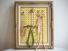 framed jewelry hanger.