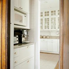 Butler's Pantry Drink Station~ A compact butler's pantry between the kitchen and dining room keeps beverages handy. With small appliances tucked into the space, one person can prepare light breakfast items and drinks while another works in the kitchen.