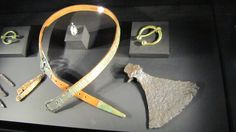 "Belt, brooches and axe. ""Vikings"" Exhibit at Field Museum, Chicago, Illinois, Field Museum, Chicago Illinois, Axe, Exhibit, Vikings, Brooches, Bones, Scandinavian, Belt"