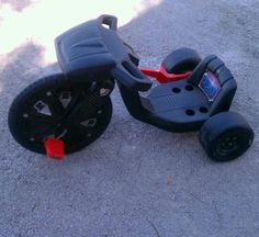 Knight Rider big wheel!  I totally had this till my neighbors fat ass sat on it