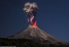 Lightning Strikes inside an Ash Cloud from Erupting Colima Volcano in Mexico