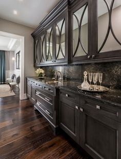 Kitchen Interior Remodeling Dark floors with dark cabinetry Kylemore Communities Peyton Model Home Black Kitchens, Home Kitchens, Farmhouse Kitchens, Modern Farmhouse, Interior Design Kitchen, Kitchen Decor, Kitchen Ideas, Kitchen Storage, Kitchen Art