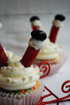 Santa Claus Cupcakes...use red licorice for legs...what a great idea!