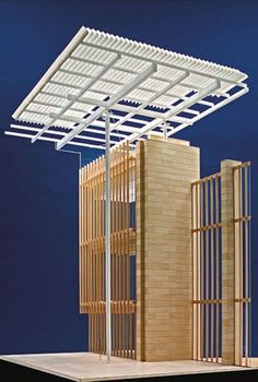 "[A3N] : Renzo Piano's model for the Art Institute of Chicago's new wing, showing its limestone wall, glass curtain and ""flying carpet"" roof"