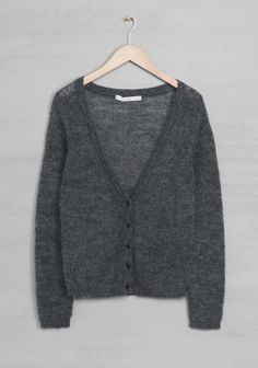 A straight-fit, mohair-blend cardigan with a delicate, feminine style. - Deep V-neck- Buttons, centre front- Small front pocket- Ribbed trims- Length: 62 cm (size 38)
