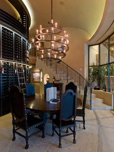foyer chandeliers Wine Cellar Contemporary with candle chandelier ceiling lighting concrete floor curved