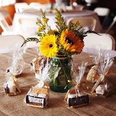 Perfect table centerpiece for what I've been thinking... Sunflower centerpiece & a great fall favor like s'mores!