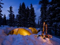 Glowing tent in the snow.