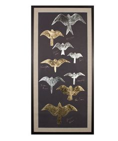 Tolstoys Birds 2, Gold Leaf - Varied shades of metallic leaf fill the silhouettes of several species of birds of prey in these dark and distinctive art prints for the birder, the lover of nature, or the bold transitional decorator. The rectangular Tolstoy's Birds artworks are created in gleaming antiqued metal shades on panels of black paper which has been hand-deckled and floated on beds of linen within well-turned black frames. The effect is stunning: dramatic enough to catch the eye in…