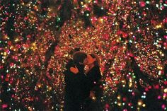 Kissing under Christmas lights. Adorable.