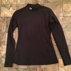 Under Armour compression top High neck, long sleeve compression top, never worn. Size Large but can fit a medium as well. No trades or PP Under Armour Tops