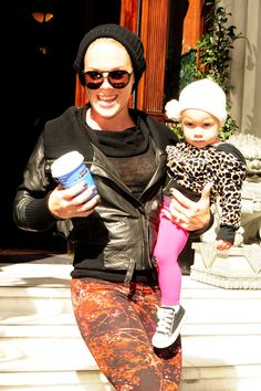 Singer Pink has her hands full as she leaves her hotel with baby daughter Willow in one hand and a coffee in the other in London
