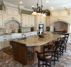 I definately have a thing for white cabinets.  I love this kitchen, needs different flooring though.