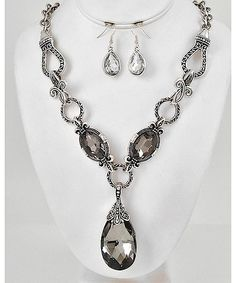 https://shoplately.com/u/g2992szr Antique Silver Tone Metal / Black Diamond Glass / Lead&nickel Compliant / Fleur De Lis Design / Pendant Necklace set