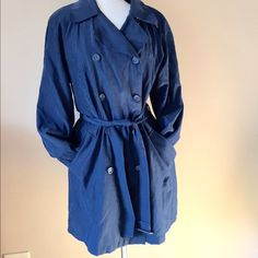 HP 1/10 London Fog Trench Coat Dark Blue Double breasted trench from London Fig. Dark cobalt blue color. Fabric feels like suede-like microfiber; machine washable; fully lined. Shown on size 6/8 mannequin. Check out the $6 section near the bottom of my closet (before the sold items) for lots of bundle-worthy $6 items! 15% bundle discount on 2+ items in a bundle. London Fog Jackets & Coats Trench Coats