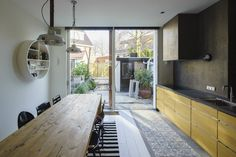 Owners of a row house built in 1900 reached out to Ruud Visser Architecten to design a modern extension on the back that resembled their neighbors. Style At Home, Interior Design Kitchen, Interior Decorating, Sweet Home, House Built, Large Windows, Architectural Elements, Interiores Design, Home Fashion
