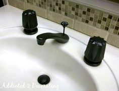 BEFORE Faced with dated brass bathroom faucets but don't want to get rid of them or replace them? Perhaps you should try spray painting your bathroom hardware!