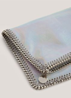 Stella McCartneyFalabella holographic clutch. Things edged with chain. Awesome.