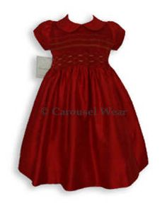 This absolutely beautiful elegant smocked Girls red silk dress is exquisite for those extra special occasions or during the Christmas season. It will stand out in that winter wedding, pictures, or that winter pageant. The tiny beads in the smocking give it that touch of elegance you are looking for in a Christmas dress. Made in 100% red silk.