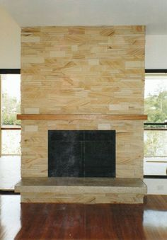 A stunning sandstone tile fireplace surround stretches all the way