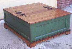 """Pine blanket box or coffee table    One of Darrels' wonderful recycled pieces...doors, hardware and lumber from an old farmhouse miraculously transformed into a 48""""x48"""" table. Two doors lift to access the large open storage area inside. Perfect for the family games, movies and blankets. Please call or contact me for a shipping price to your area.    $750.00 per each"""