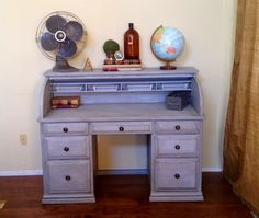 Vintage roll top desk (roll top enclosure removed) done in a gray/grey finish with a black glaze, clear wax, and vintage numbered wood knobs. Search Revamped Home Furnishings on Facebook in Paso Robles, CA to see more available pieces.