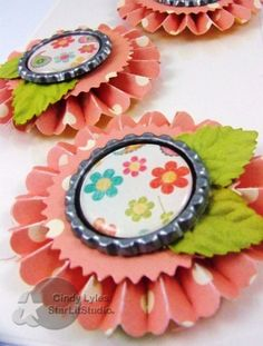 My neighbor and friend turns 50 and asked me to make her invites...required lots and lots of paper rosettes... Started with October Afternoon's Lemon Drops and used Sizzix's Paper Rosette die. Assembly video tutorial on these paper rosettes using this...