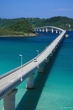 Tsunoshima Bridge - photo by tomosang R32m, via Flickr;  Once separated from Honshu (Japan's main island), Tsunoshima is now accessible via the 5,840 feet long Tsunoshima Bridge, which was completed in the year 2000.  Yamaguchi Route 276 will take travelers across the bridge to the small island of Tsunoshima.