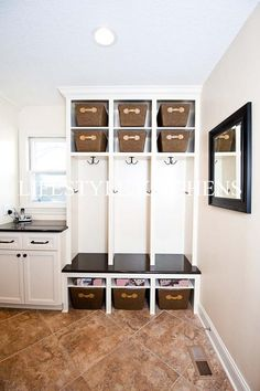 Mudroom idea - A nice idea for many spaces, a corner in the kitchen, can hang a curtain, tablecloth even a quilt on curtain rod rings with clips that are loose and slide quick and easily across the rod in either direction for a no hassle access to your items, leave the baskets showing, they always make a area look rich and neat, like it's been decorated and completed. Basement Remodel Diy, Basement Remodeling, Garage Remodel, Remodeling Ideas, Basement Kitchen, Rustic Basement, Entry Way Lockers, Garage Entry, Cement Walls