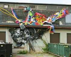 Bordalo II (previously) has created a series of bisected animals, colorful plastics forming one half of the creature while a combination of wood and metal created amuted mirror on the other side. In one piece the Portuguese artist created a turtle with legs that extend to the ground, appearing to c