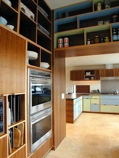Walnut plywood kitchen cabinets and signature asymmetrical cubbies with green and blue laminate!